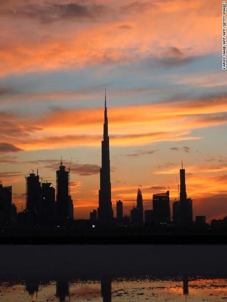 A general view shows Burj Khalifa (C), the world's tallest tower, as the sun sets over Dubai on April 4, 2016,.  / AFP / KARIM SAHIB        (Photo credit should read KARIM SAHIB/AFP/Getty Images)