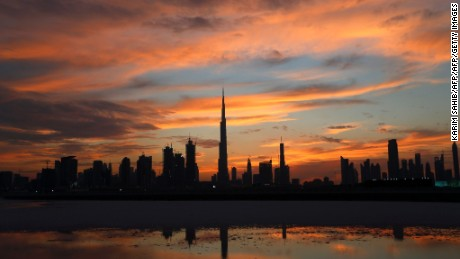 A general view shows Burj Khalifa (C), the world's tallest tower, as the sun sets over Dubai on April 4, 2016,.  / AFP / KARIM SAHIB        (Photo credit should read KARIM SAHIB/AFP/Getty Images)