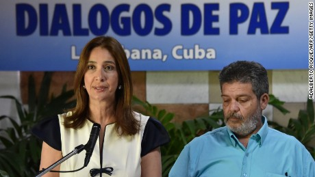 Colombian delegation spokeswoman Marcela Duran and the FARC's Marcos Calarca address the ceasefire deal Wednesday in Havana.