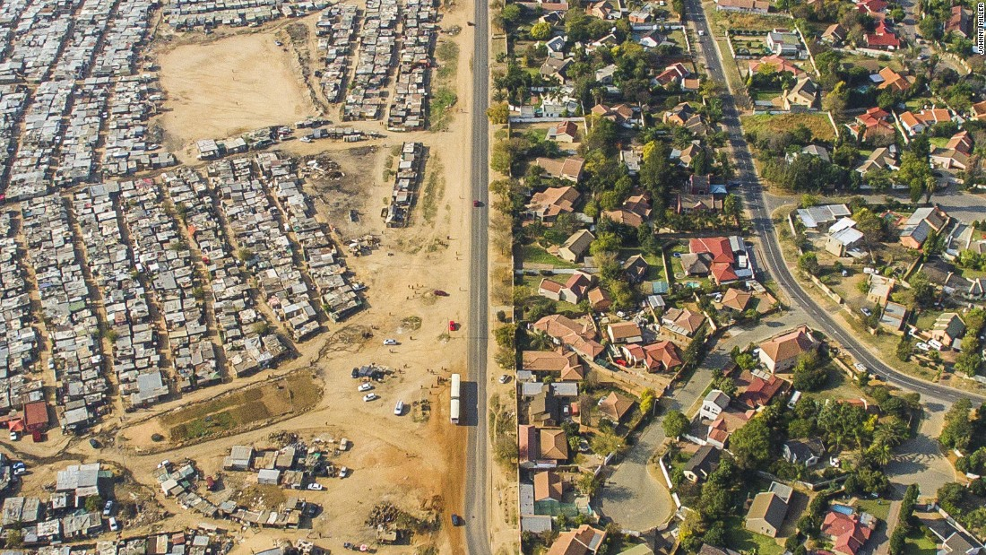 """""""This was a very objective aerial view"""" says Miller, adding that viewers can """" stop thinking this is a white or black issue, or 'I'm looking at a poor or a rich person.' They are almost looking at a map or puzzle."""""""
