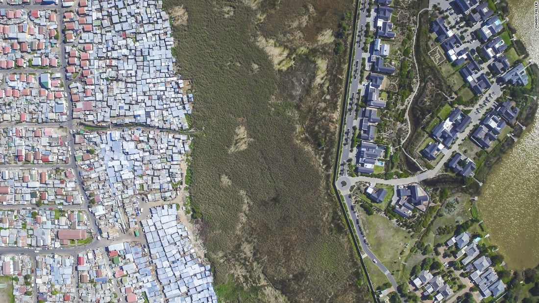 """Pictured are the neighboring areas of Masiphumelele and Lake Michelle. Although Masiphumelele was not set up during apartheid, it is a former township. <br />""""Black people lived in these areas usually fenced off or somehow separated from other areas through buffer zones such as highways, green belts, train tracks or rivers,"""" notes Miller."""
