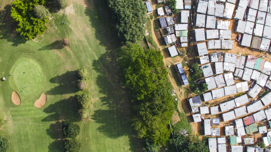 """The Papwa Swegolum golf course sits next to a densely populated township. <br />""""Within these townships are dense poorly designed properties. In Masiphumelele for example  there are 38,000 people that live in that area"""", says Miller."""
