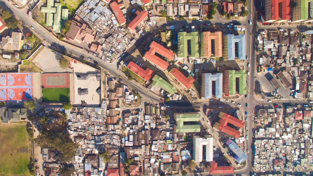 """Photographer Johnny Miller has used a drone to take aerial photographs to demonstrate the gap between the wealthy and the poor in Cape Town, South Africa. """"During apartheid, segregation of urban spaces was instituted as policy,"""" he writes on the site dedicated to the project, <a href=""""http://unequalscenes.com/projects"""" target=""""_blank"""">Unequal Scenes</a>. It's been 22 years since the fall of apartheid, and he notes the pre-apartheid barriers still exist."""