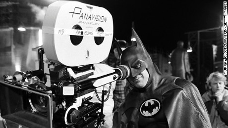 American actor Michael Keaton tries the view from behind the camera, during the filming of 'Batman', 1989.  (Photo by Murray Close/Getty Images)