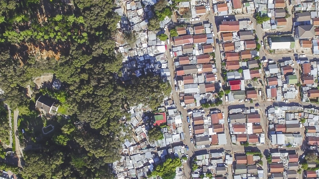 """Hout Bay is the image that seems to resonate with South Africans the most, says Miller. """"The red roofed houses are actually government houses. The tin shacks all around it are the informal settlements""""."""