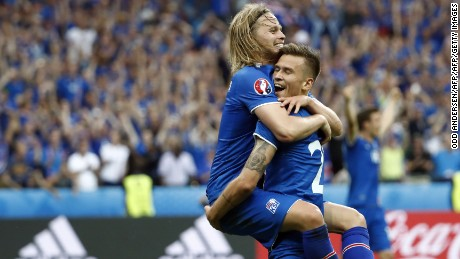 TOPSHOT - Iceland's midfielder Arnor Ingvi Traustason celebrates scoring the team's second goal with teammate Iceland's midfielder Birkir Bjarnason (top) during the Euro 2016 group F football match between Iceland and Austria at the Stade de France stadium in Saint-Denis, near Paris on June 22, 2016. / AFP / ODD ANDERSEN        (Photo credit should read ODD ANDERSEN/AFP/Getty Images)