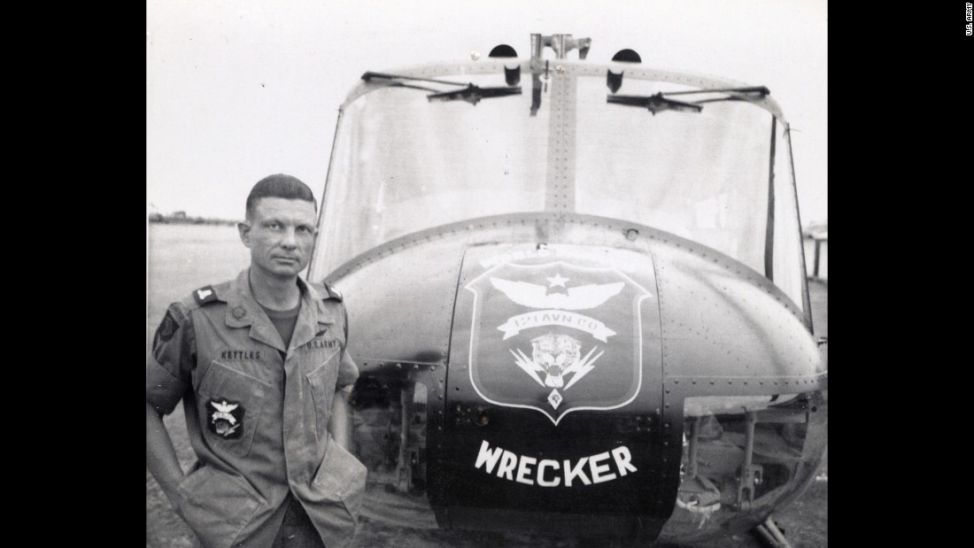 Maj. Charles Kettles poses in front of a 121st Aviation Company, UH-1H helicopter, during his second tour of duty in Vietnam in 1969. During his first tour with the 176th Aviation Company in May 1967, Kettles displayed extraordinary daring and bravery when he landed his helicopter in the middle of a battle to save eight soldiers who had been left behind after an initial rescue mission. He then managed to pilot the severely overloaded helicopter to safety. Kettles will be awarded the Medal of Honor in a July White House ceremony.