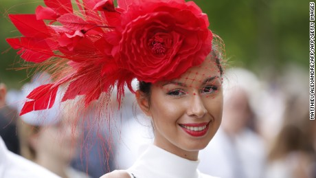 "A woman wearing a hat poses as she attends the 167th ""Prix de Diane"", a 2100-metre flat horse race, on June 19, 2016 in Chantilly, north of Paris.  / AFP / MATTHIEU ALEXANDRE        (Photo credit should read MATTHIEU ALEXANDRE/AFP/Getty Images)"