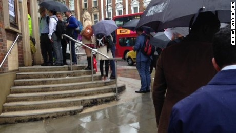 Rain doesn't deter voters from casting ballots in London's West Hampstead.