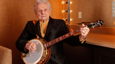 FILE - In this March 11, 2011 file photo Ralph Stanley poses for a photo backstage at the Grand Ole Opry House in Nashville, Tenn. Stanley, the last of the original bluegrass legends arrives Saturday, June 14, 2014, at the Huck Finn Jubilee in Ontario for a rare Southern California appearance that was to be part of a farewell tour, that was until he put his retirement on hold. (AP Photo/Ed Rode, File)