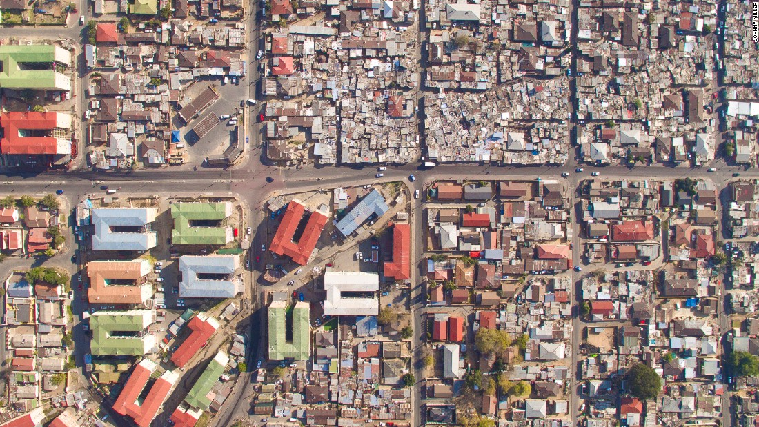 """Pictured: Alexandra, Sandton. When taking images, Miller maintained a height of 160 to 200 feet and moved as quickly as possible to ensure individual privacy. """"No one likes a drone hovering in front of their house,"""" he says."""