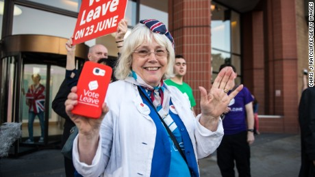 """Leave"" supporter Christine Forrester celebrates the Brexit vote result outside Vote Leave headquarters in London on Friday, June 24."
