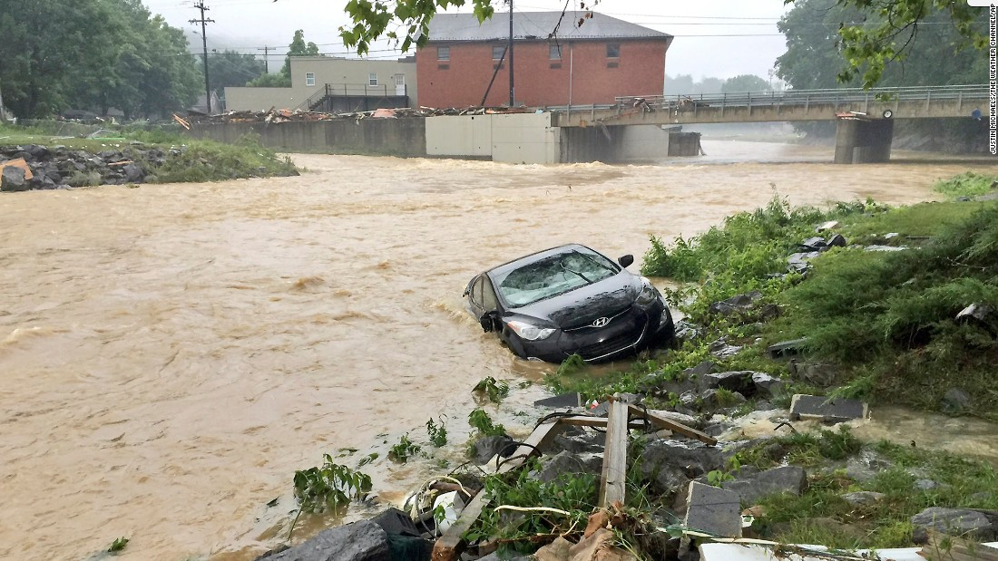A vehicle is washed away in White Sulphur Springs on June 24.