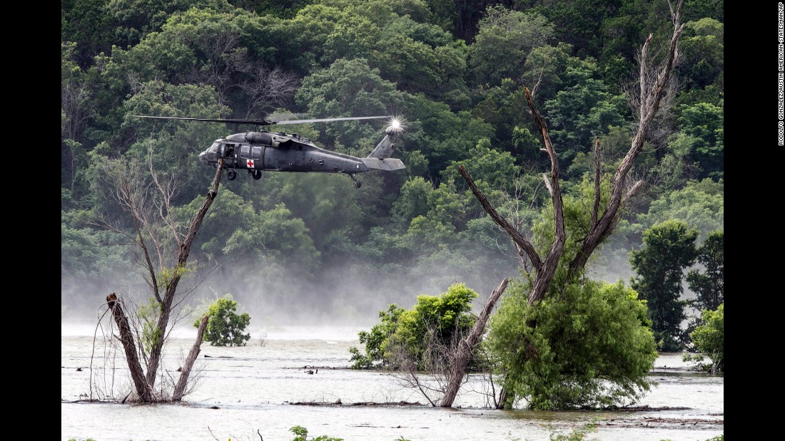 "Army helicopters hover above Belton Lake on Friday, June 3, as they look for missing soldiers who were swept away by floodwaters in Texas. <a href=""http://www.cnn.com/2016/06/03/us/texas-floods/"" target=""_blank"">Nine soldiers from Fort Hood were killed</a> when their vehicle overturned during a training mission."