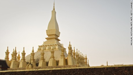 A man walks around the That Luang Stupa in Vientiane, the capital of Laos, on April 12, 2012 ahead of the visit by former Thai prime minister Thaksin Shinawatra. Thaksin, who was toppled by royalist generals in 2006 and lives in Dubai to avoid a two-year prison sentence for corruption that he contends is politically motivated, is visiting the country and will meet with supporters next in neighbouring Cambodia.    AFP PHOTO / Nicolas ASFOURI        (Photo credit should read NICOLAS ASFOURI/AFP/Getty Images)