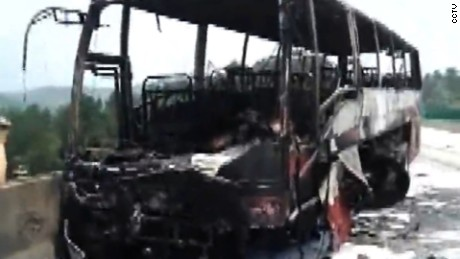 The tour bus caught fire after ramming into a guardrail in China.