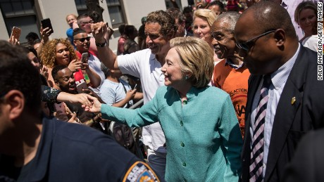 Hillary Clinton, flanked by New York Governor Andrew Cuomo and Rev. Al Sharpton, attends the New York City Gay Pride Parade, June 26, 2016 in New York City.