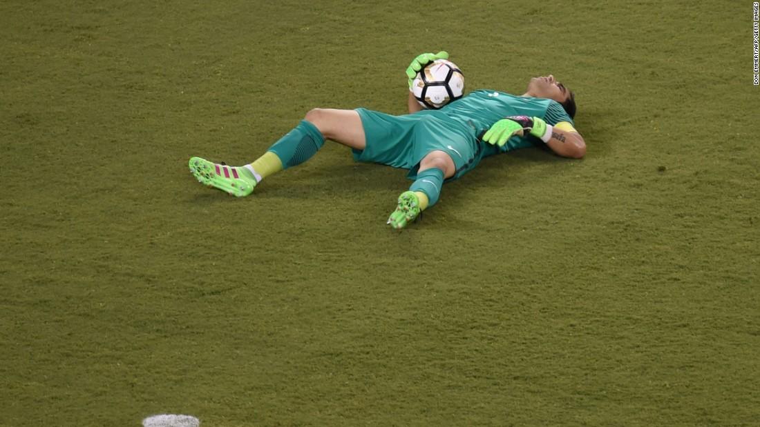 Chile's goalkeeper Claudio Bravo lies on the ground.