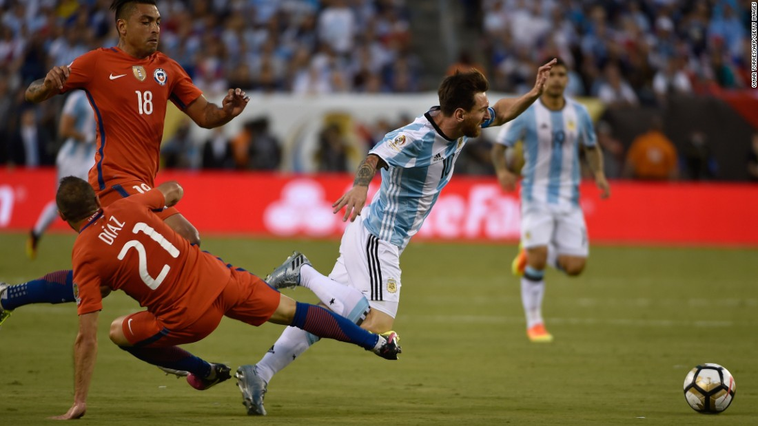 Argentina's Lionel Messi, right,  is fouled by Chile's Marcelo Diaz.