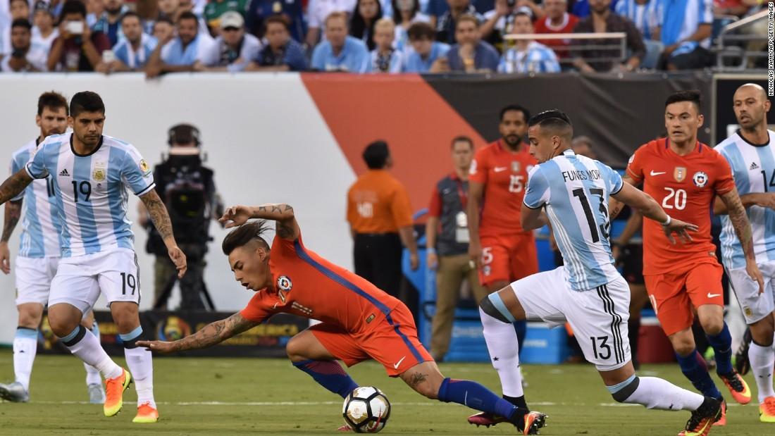 Chile's Eduardo Vargas is fouled by Argentina's Ramiro Funes Mori.