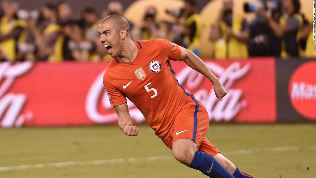Chile's Francisco Silva celebrates scoring the deciding penalty kick.