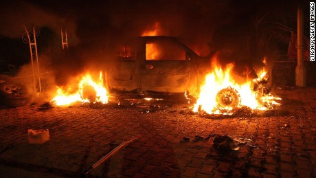 A vehicle and the surrounding area are engulfed in flames after it was set on fire inside the US consulate compound in Benghazi late on September 11, 2012. An armed mob protesting over a film they said offended Islam, attacked the US consulate in Benghazi and set fire to the building, killing one American, witnesses and officials said.    AFP PHOTO        (Photo credit should read STR/AFP/GettyImages)