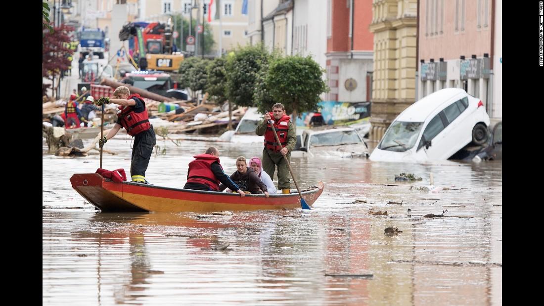 Firefighters rescue two women following heavy floods in Simbach am Inn, Germany, on Thursday, June 2.