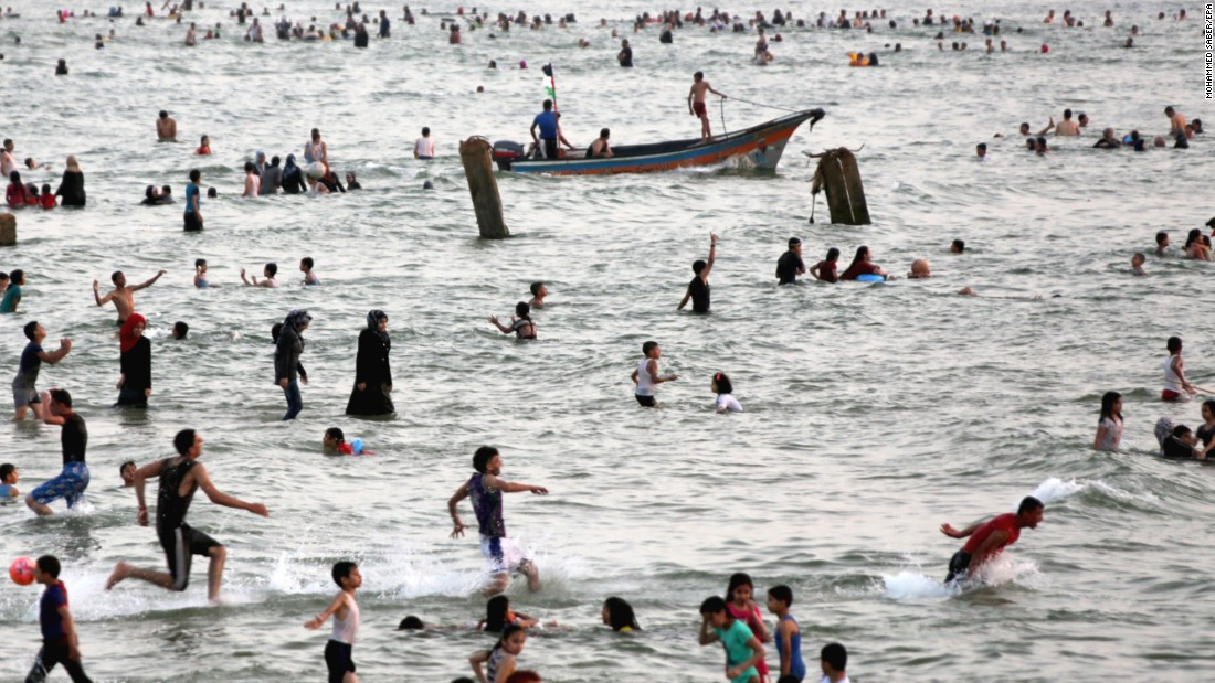 People enjoy the beach west of Gaza City on Friday, June 3.