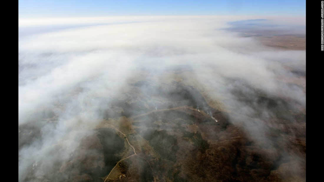 """A smoke plume of the <a href=""""http://www.cnn.com/2016/06/21/us/fires-heat-wave-southwest-united-states/"""" target=""""_blank"""">Dog Head wildfire</a> is seen over the Manzano Mountains of New Mexico on Friday, June 17."""