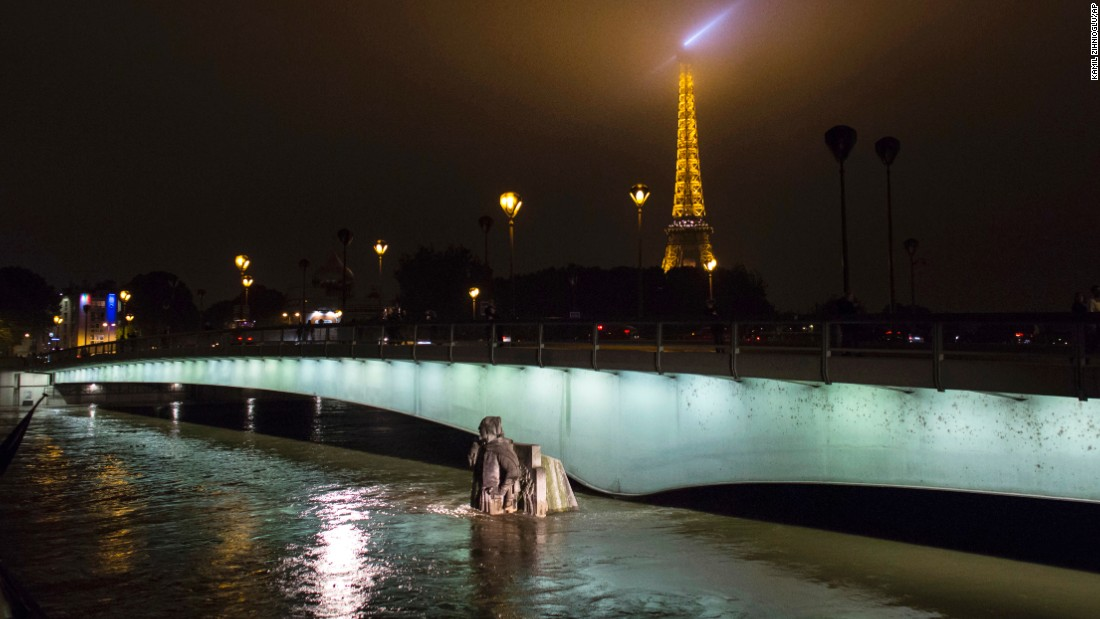"""The Zouave statue at the Pont de l'Alma bridge, which serves as a measuring instrument for water levels during floods, is partly covered by the Seine River in Paris on Friday, June 3. The Seine River <a href=""""http://www.cnn.com/2016/06/03/europe/france-germany-flooding-art/"""" target=""""_blank"""">spilled into Paris streets,</a> forcing many landmarks to shut down as it surged to its highest levels in nearly 35 years."""