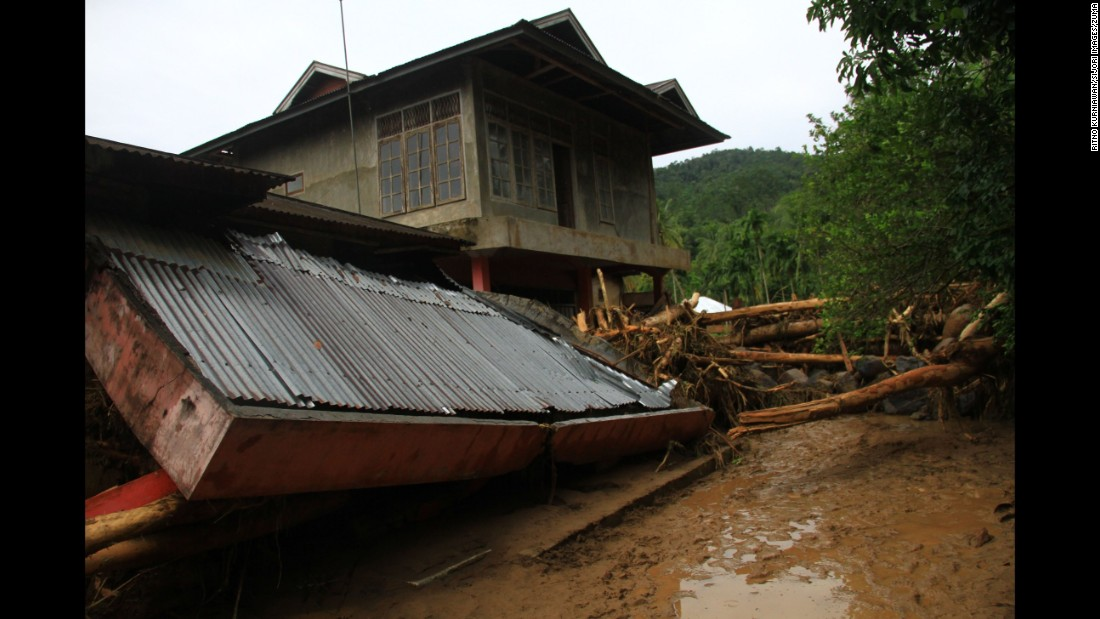 Floodwaters from the Batang River carried debris that damaged homes and rice fields in Pariaman, Indonesia, on Friday, June 17.