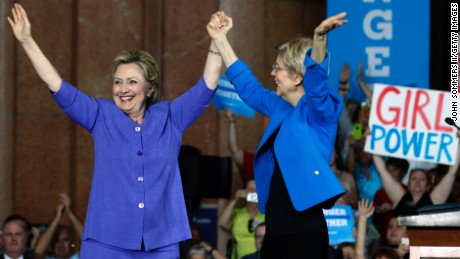 Democratic Presidential candidate Hillary Clinton (L) and U.S. Sen Elizabeth Warren (D-MA) (R) wave to the crowd before a campaign rally at the Cincinnati Museum Center at Union Terminal June 27, 2016 in Cincinnati, Ohio. Warren is helping Clinton campaign in Ohio.