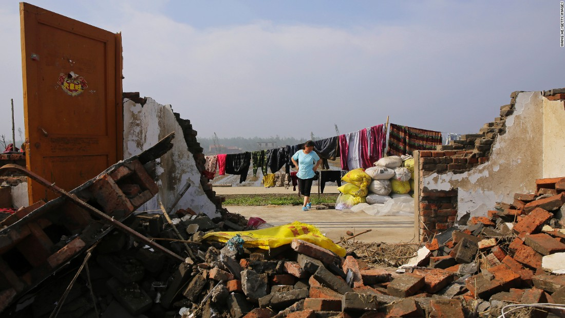 """A villager dries clothes in China's Jiangsu Province on Saturday, June 25. <a href=""""http://www.cnn.com/2016/06/23/asia/china-tornado/"""" target=""""_blank"""">At least 98 people were killed and 800 more were injured</a> after a tornado -- accompanied by hailstorms, thunderstorms and lightning -- hit eastern China, the government said."""