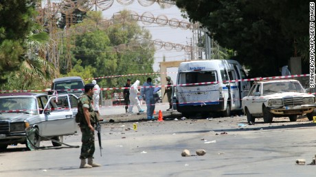 Lebanese security forces secure the site of the suicide attacks early on June 27.