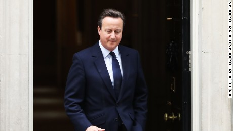 British Prime Minister David Cameron leaves 10 Downing Street following the first Cabinet meeting since the EU referendum.