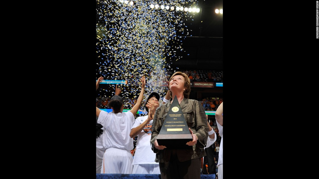 Tennessee Volunteers coach Pat Summitt holds the championship trophy after winning the SEC Women's Basketball Tournament Championship game on March 4, 2012 in Nashville.