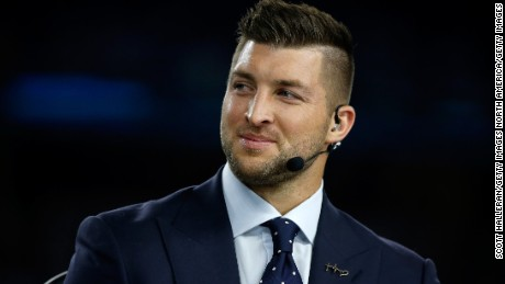 Tim Tebow of the SEC Network speaks on air before the Goodyear Cotton Bowl on December 31, 2015, in Arlington, Texas.