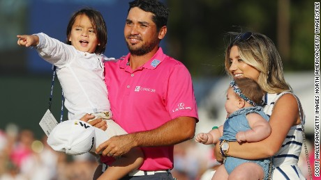 PONTE VEDRA BEACH, FL - MAY 15:  Jason Day of Australia celebrates with son Dash, wife Ellie and daughter Lucy after winning during the final round of THE PLAYERS Championship at the Stadium course at TPC Sawgrass on May 15, 2016 in Ponte Vedra Beach, Florida.  (Photo by Scott Halleran/Getty Images)