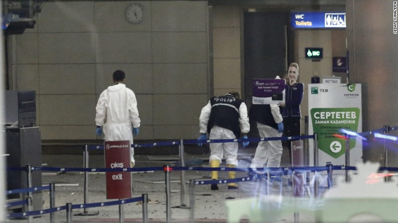 Police investigators work inside the airport.