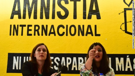 """Erika Guevara-Rosas (R), director for the Americas of Amnesty International speaks next to Madeleine Penman researcher on Mexico for Amnesty International (L) during the presentation of the report  """"Survive to the death"""" on torture to women in jails of Mexico, on June 28, 2016, in Mexico city. / AFP / RONALDO SCHEMIDT        (Photo credit should read RONALDO SCHEMIDT/AFP/Getty Images)"""