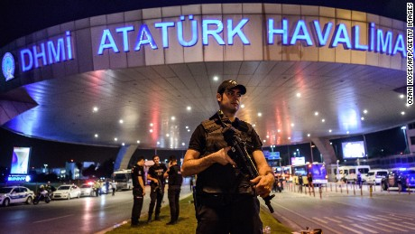 A Turkish riot police officer patrols Ataturk airport`s main enterance in Istanbul, on June 28, 2016, after two explosions followed by gunfire hit Turkey's largest airport, killing at least 10 people and injuring 20.  All flights at Istanbul's Ataturk international airport were suspended on June 28, 2016 after a suicide attack left at least 36 people dead.  / AFP / OZAN KOSE        (Photo credit should read OZAN KOSE/AFP/Getty Images)
