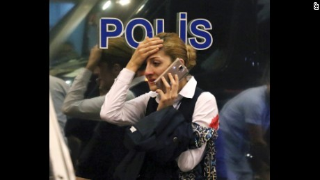 A woman reacts outside Istanbul's Ataturk airport, Tuesday, June 28, 2016. Suspected Islamic State group extremists have hit the international terminal of Istanbul's Ataturk airport, killing dozens of people and wounding many others, Turkish officials said Tuesday. Turkish authorities have banned distribution of images relating to the Ataturk airport attack within Turkey. (DHA via AP) TURKEY OUT
