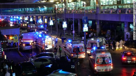 Security and ambulances block the road outside Turkey's largest airport, Istanbul Ataturk, after it was hit by a suicide bomb attack on Tuesday, June 28. Two suicide bombers opened fire before blowing themselves up at the entrance to the main international airport in Istanbul, killing at least 36 people and wounding others.