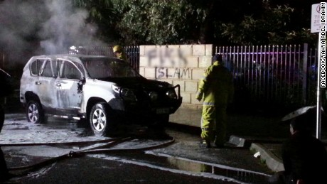 The scene outside a mosque in Perth, Australia, where cars were set alight in an anti-Muslim attack on June 28