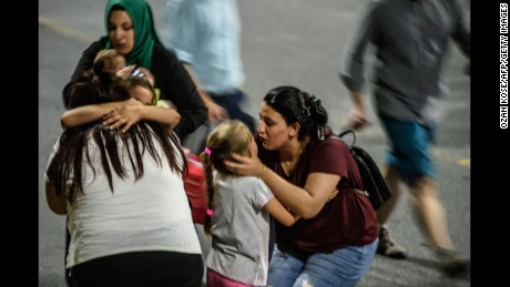 Children and their relatives embrace after reuniting outside the airport on June 28.
