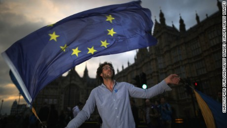 LONDON, ENGLAND - JUNE 28:  A protester waves an EU flag in front of the Houses of Parliament as they demonstrate against the EU referendum result on June 28, 2016 in London, England. Up to 50,000 people were expected before the event was cancelled due to safety concerns. Early evening up to 2000 people have still converged on the square and then marched to Parliament to vent their anti-Brexit feelings.  (Photo by Christopher Furlong/Getty Images)