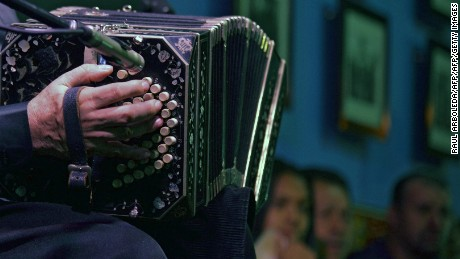 """A man plays teh bandoneon during a tribute to tango singer and composer Carlos Gardel at the """"Casa Gardeliana"""" Museum in Medellin, Antioquia department, Colombia, on June 22, 2015. Next June 24th marks the 80th anniversary of Gardel's death in an air crash in Medellin, Colombia. AFP PHOTO / Raul ARBOLEDA        (Photo credit should read RAUL ARBOLEDA/AFP/Getty Images)"""