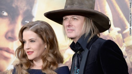 "Singer Lisa Marie Presley and musician Michael Lockwood attend the premiere of Warner Bros. Pictures' ""Mad Max: Fury Road"" at TCL Chinese Theatre on May 7, 2015 in Hollywood, California."