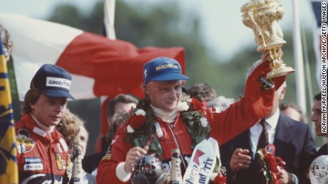 Niki Lauda of Austria and driver of the #8 Marlboro McLaren International McLaren MP4B Ford Cosworth DFV V8 lifts the RAC Trophy and celebrates with second placed Didier Pironi after winning the Marlboro British Grand Prix on 18 July 1982 at the Brands Hatch circuit in Fawkham, Great Britain. (Photo by Adrian Murrell/Getty Images)