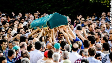 People carry the coffin of suicide attack victim Mohammad Eymen Demirci on June 29 in Istanbul during his funeral.